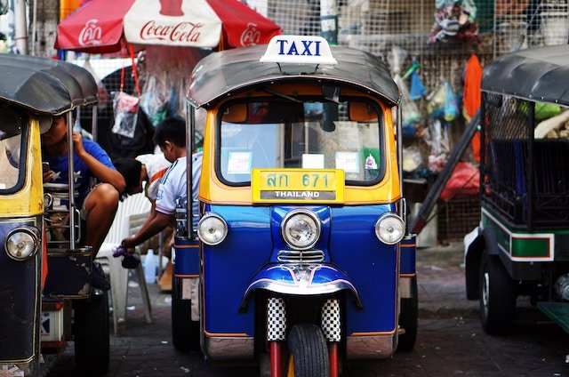 A blue and yellow Tuk Tuk in Thailand